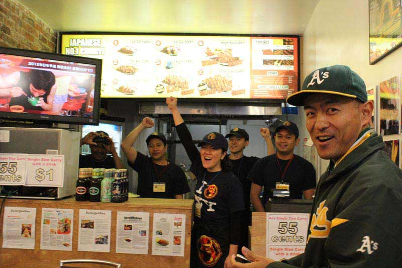 Winning team of employees cheer at Go! Go! Curry!