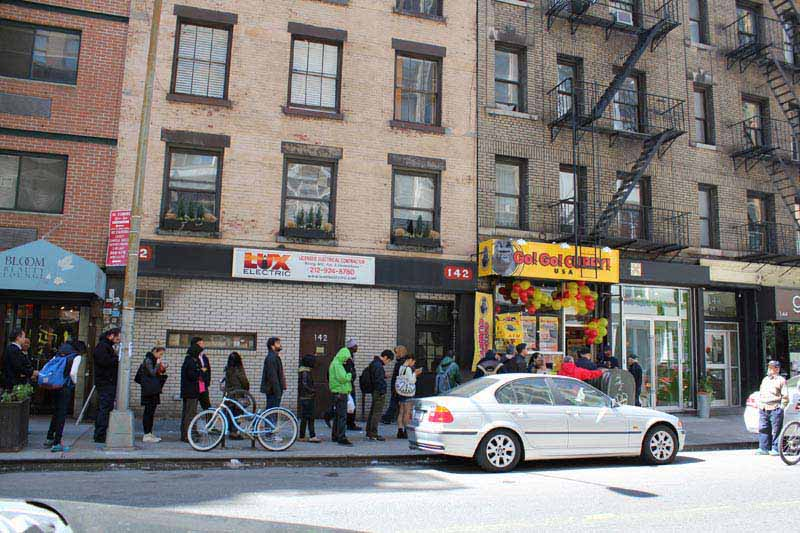 Everybody loves Go! Go! Curry! A line forms outside the grand opening of Go! Go! Curry! Harlem